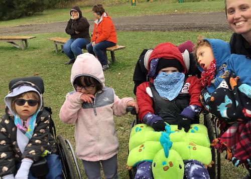 Students bundled up at the pumpkin farm